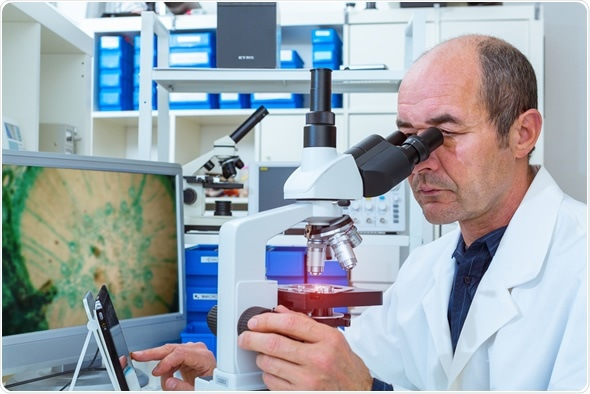 Scientist examines biopsy samples. Image Copyright: science photo / Shutterstock
