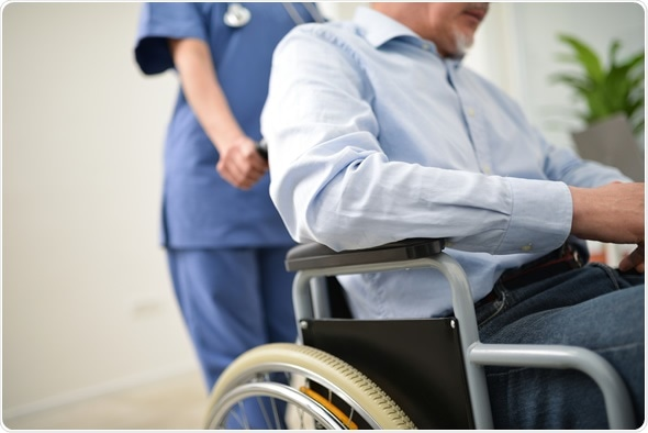 Nurse pushing an injured patient on a wheelchair - Image Copyright: Minerva Studio / Shutterstock