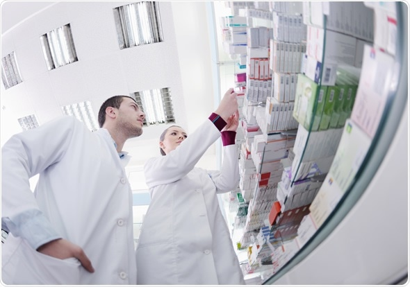 Team of pharmacist chemist woman and man group standing in pharmacy drugstore - Image Copyright: dotshock / Shutterstock