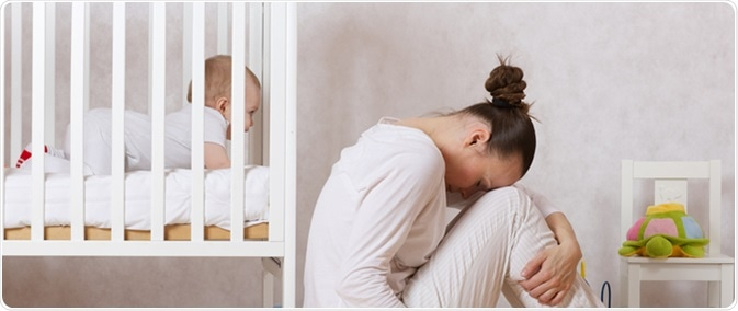 f5a25c31b39 Young mother between 30 and 40 years old is experiencing postnatal  depression. Image Credit