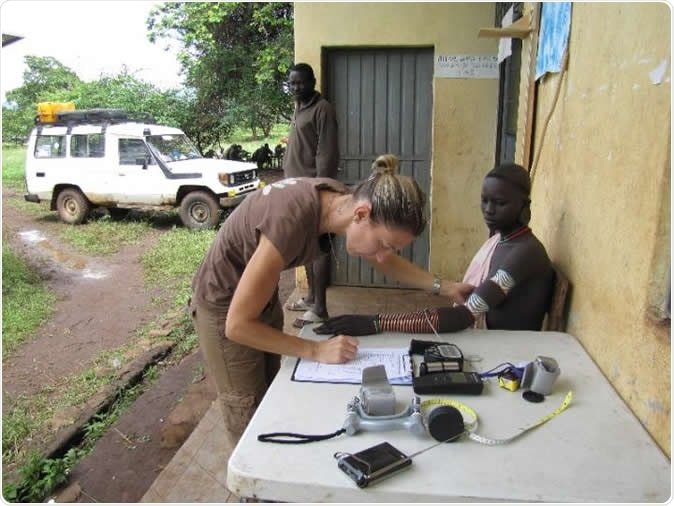 University of Pennsylvania researchers studied the genetics behind skin pigmentation of diverse African populations, finding new genetic variants associated with skin color. Here, senior research scientist Alessia Ranciaro measures the skin reflectance of a man from a Nilo-Saharan group. Members of this population tend to have very dark skin pigmentation.