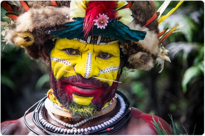 Male Huli tribe member in Tari area of Papua New Guinea in traditional clothes and face paint. Image Credit: By Amy Nichole Harris / Shutterstock