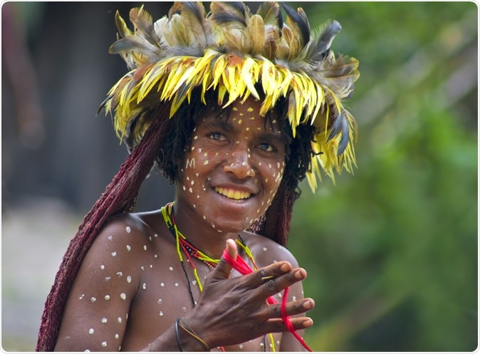 Woman of a Papuan tribe in traditional clothes and coloring in New Guinea Island. Image Credit: Byelikova Oksana / Shutterstock