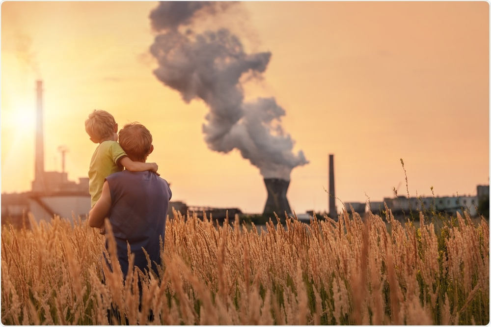 Man and his son, watching as factory pollutes the air - Global Warming Concept By Soloviova Liudmyla