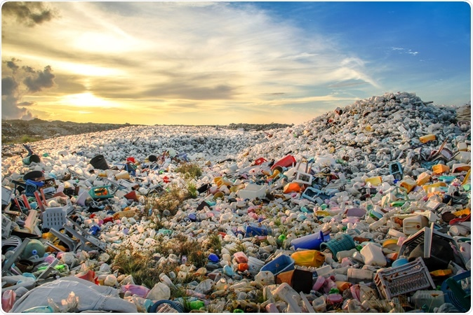 Waste plastic bottles and other types of plastic waste at disposal site. Image Credit: Shutterstock