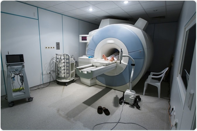 Patient being scanned and diagnosed on a MRI (magnetic resonance imaging) scanner in a hospital. Image Credit: zlikovec / Shutterstock