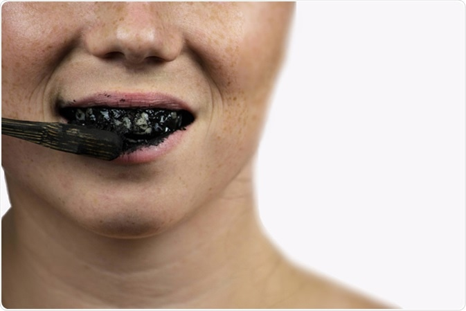 Black tooth paste with active charcoal. Image Credit: Cerrophoto / Shutterstock