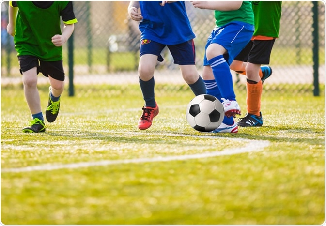 Kids playing soccer. Image Credit: Matimix / Shutterstock