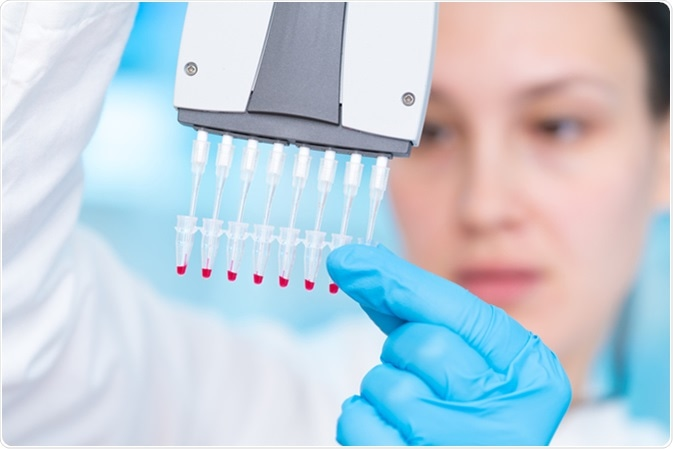 Technician with multipipette in genetic laboratory PCR research. Image Credit: Science Photo / Shutterstock