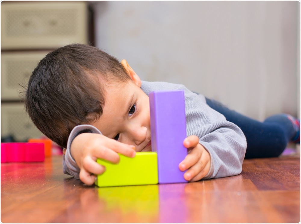 Child with autism playing with building blocks
