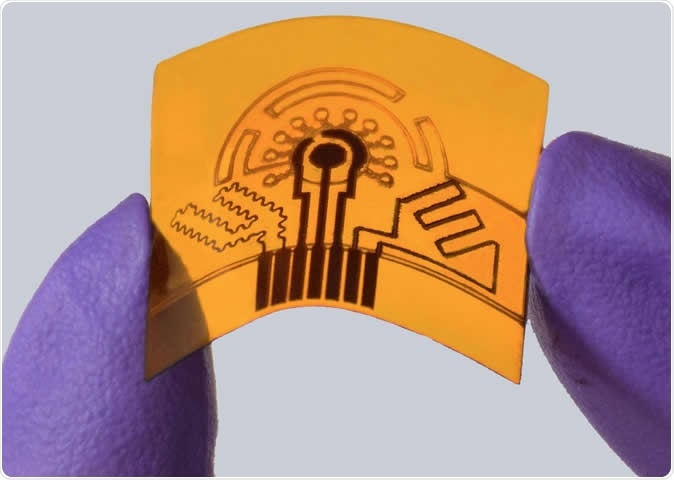 A laser-engraved, flexible sensor can monitor health conditions through sweat. Image Credit: Caltech