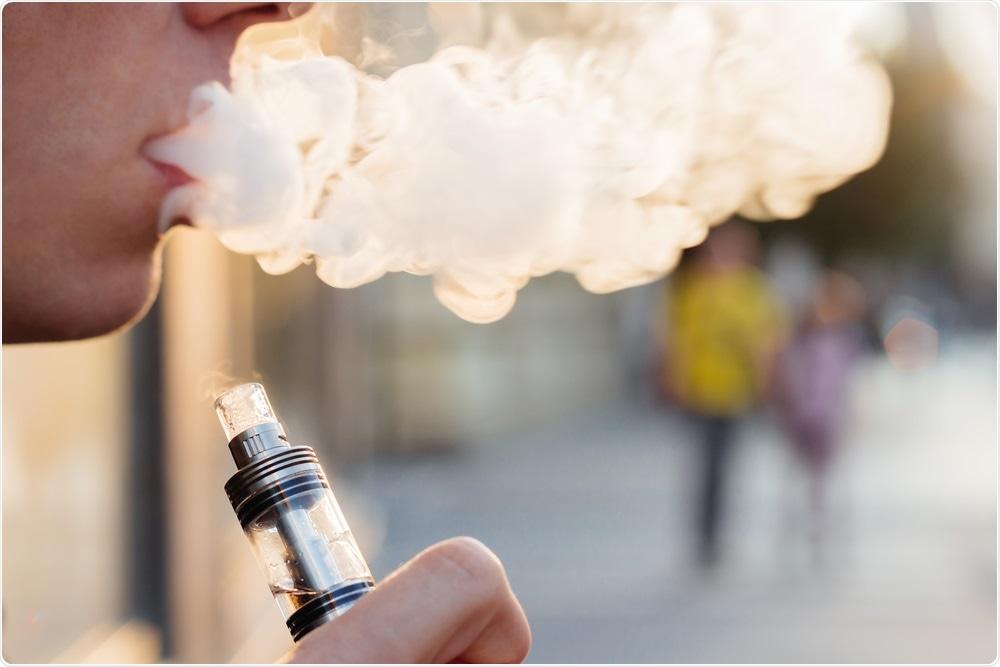 young person smoking e-cigarette