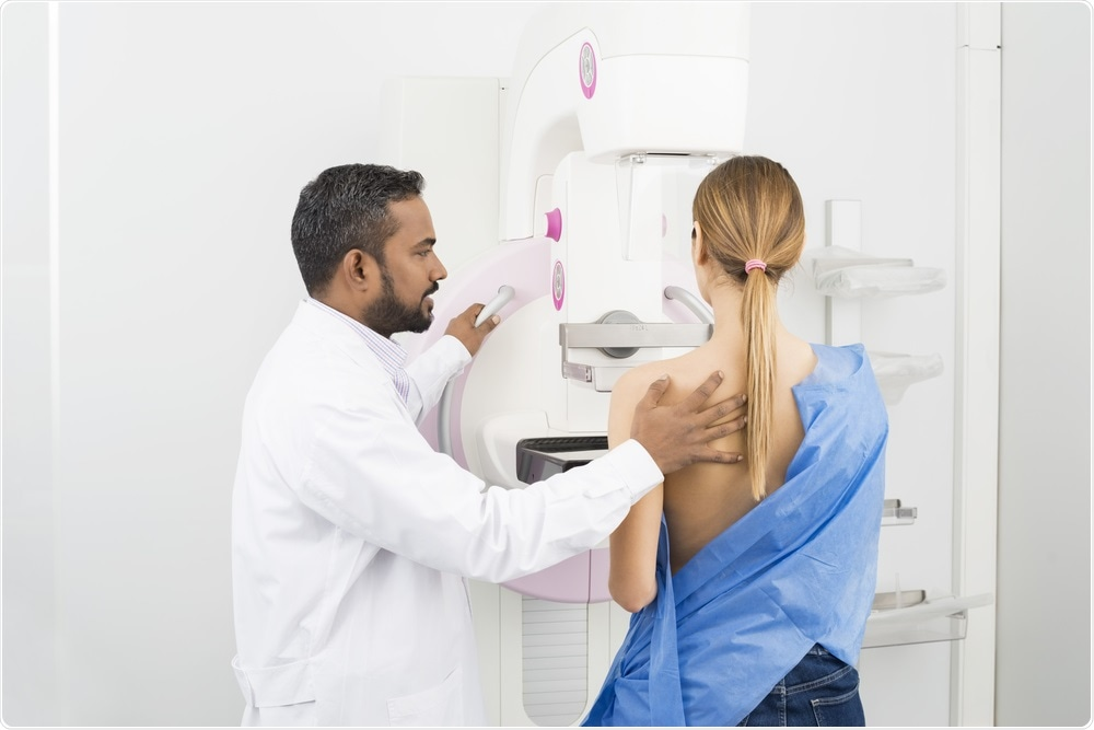 Woman undergoing mammography - breast cancer screening