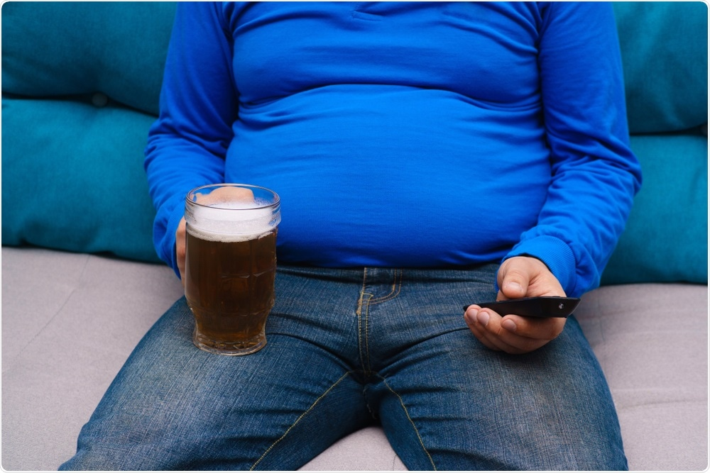 Man sat on couch - sedentary lifestyle
