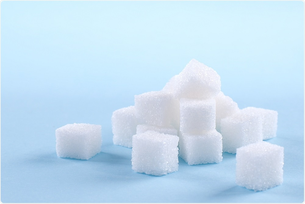 Sugar cubes on blue background