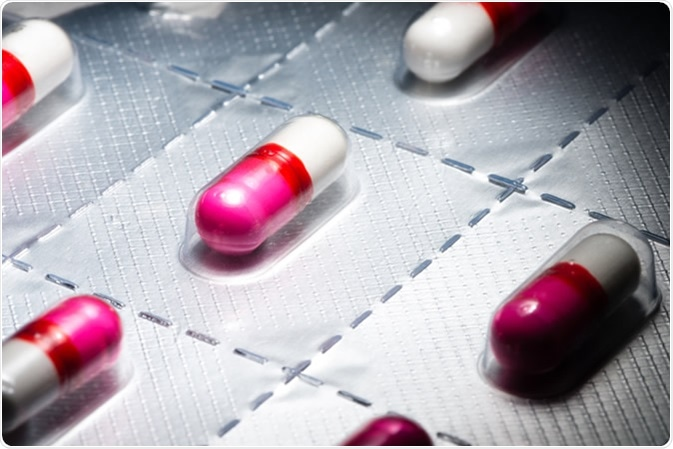 Pink antihistamine capsules in blister pack Image Credit: EHStockphoto / Shutterstock