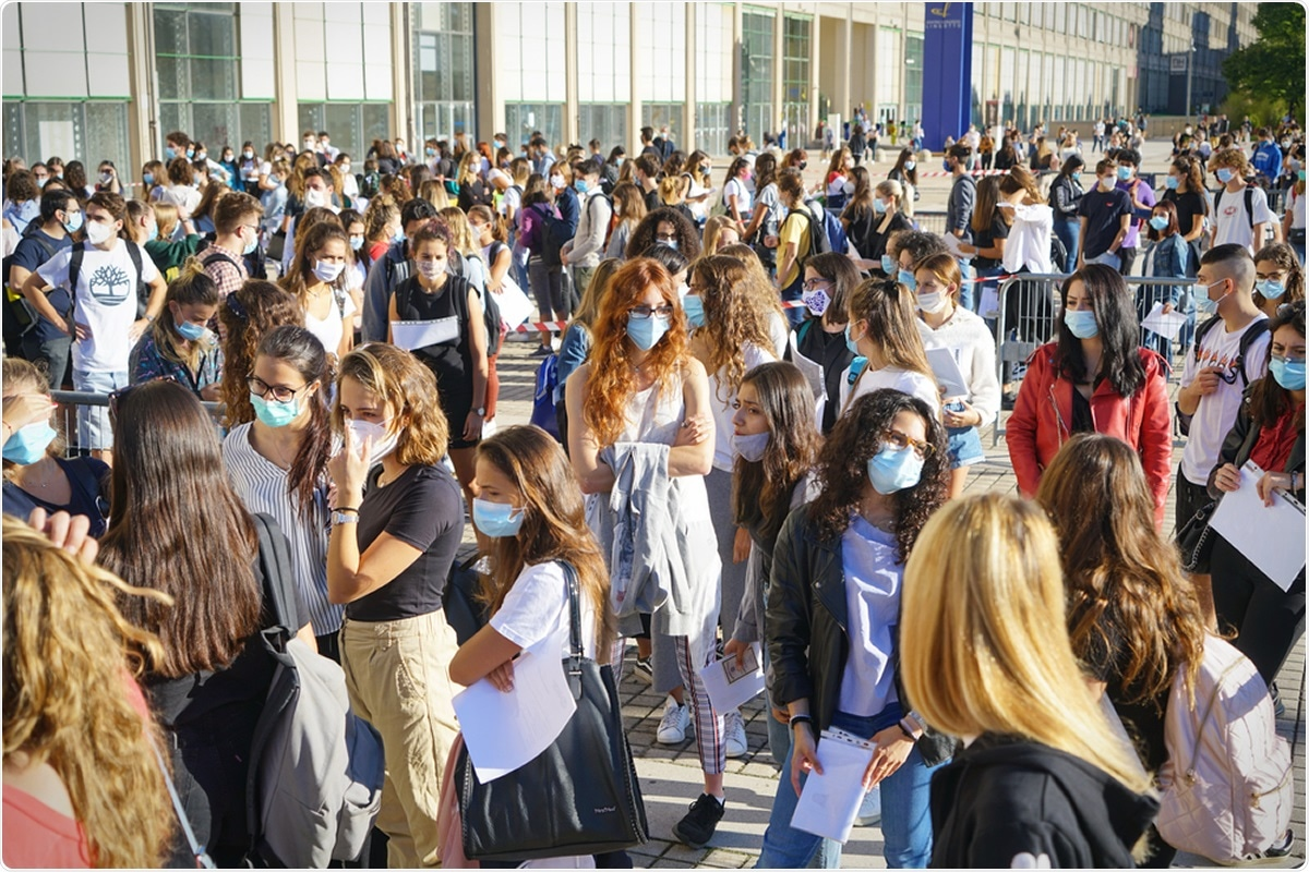 Students queuing at the school entrance. Turin, Italy - September 2020. Image Credit: Mike Dotta / Shutterstock