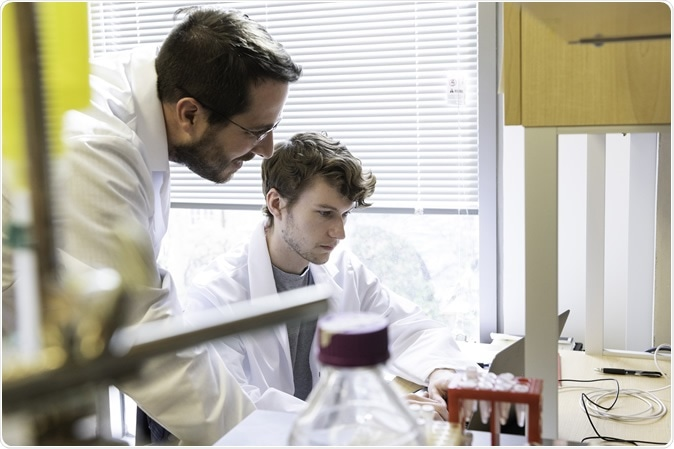 Jason S. McLellan, associate professor of molecular biosciences, left, and graduate student Daniel Wrapp, right, work in theMcLellan Lab at The University of Texas at Austin Monday Feb. 17, 2020.