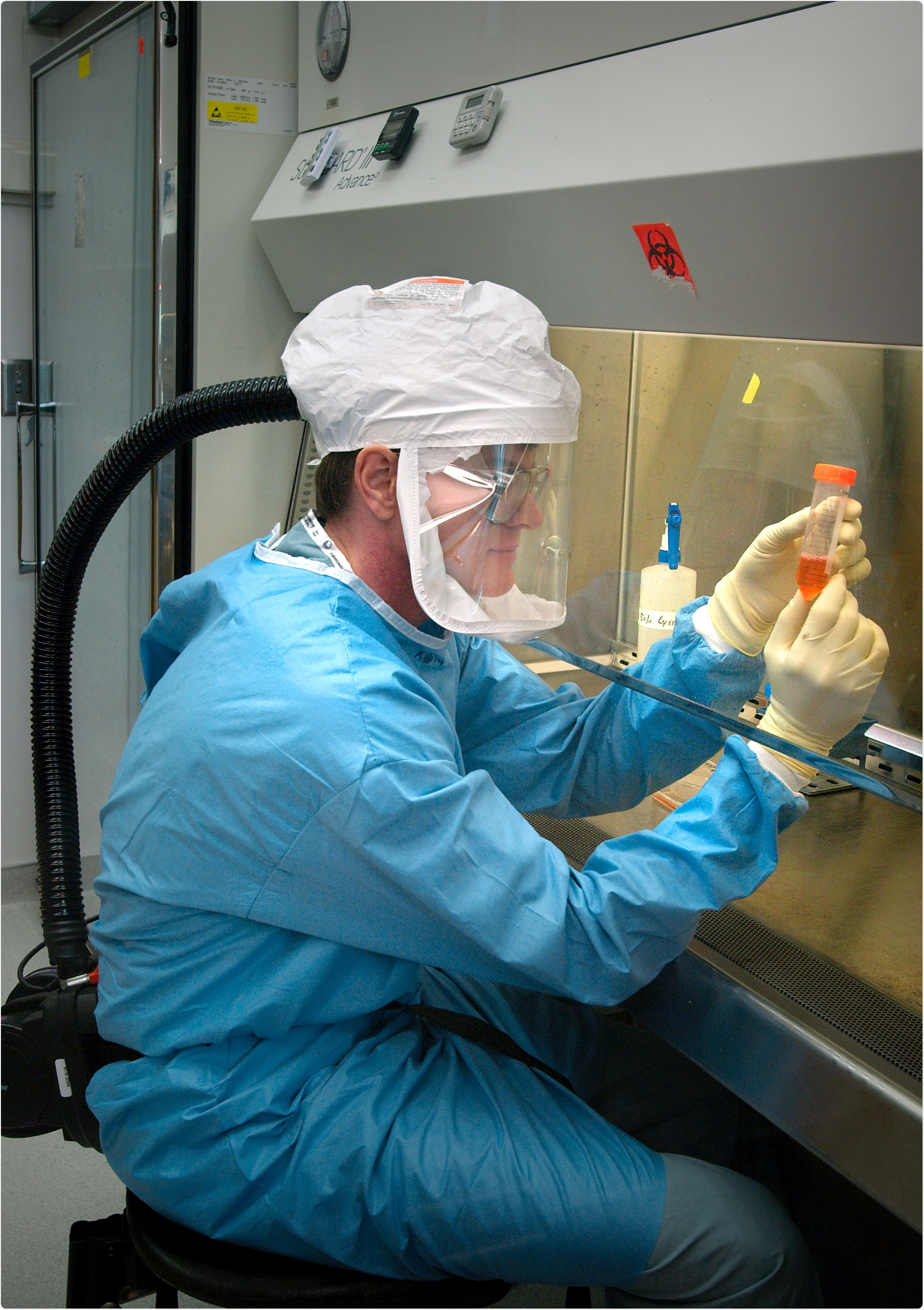 Researcher at US Centers for Disease Control, Atlanta, Georgia, working with influenza virus under biosafety level 3 conditions, with respirator inside a biosafety cabinet (BSC). Photo Credit: James Gathany Content Providers(s): CDC