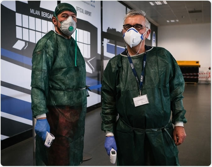 ITALY, BERGAMO- 22 February 2020: medical services at the airport Bergamo-Milano investigate aircraft passengers who have arrived in Italy to minimize the risk of the spread of the coronavirus epidemic. Image Credit: Grabowski Foto / Shutterstock