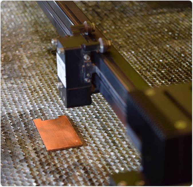A laser prepares for the surface texture of copper, increasing its antimicrobial properties. (Photo of Purdue University / Kayla Wiles)