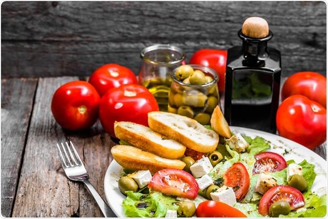 Mediterranean diet with vegetables and feta. Image Credit: Alicja Neumiler / Shutterstock