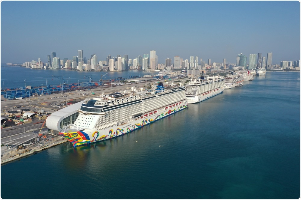Miami, Florida - April 18, 2020 - Aerial view of cruise ships at Port Miami cruise terminal during covid-19 pandemic. Image Credit: Francisco Blanco / Shutterstock