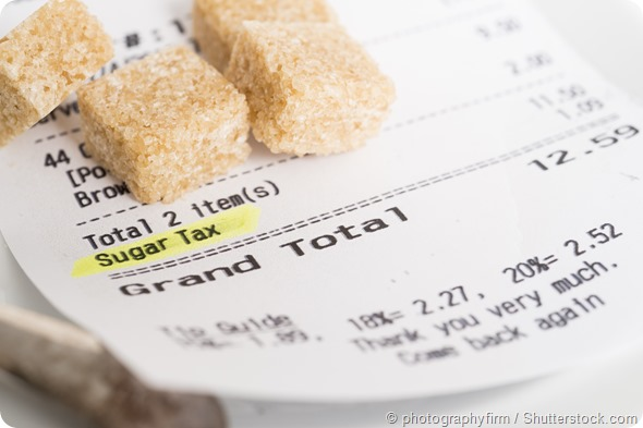 A restaurant receipt showing a sugar tax being charged