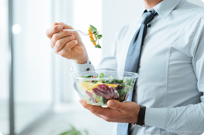 Businessman eating salad healthy