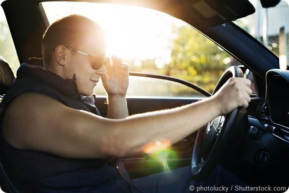 Guy in sunglasses driving car