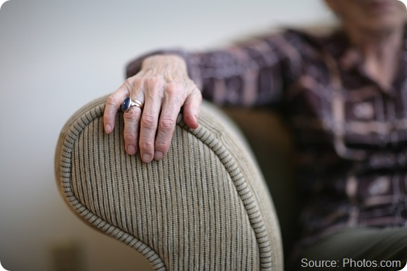 Senior woman hand on an armrest