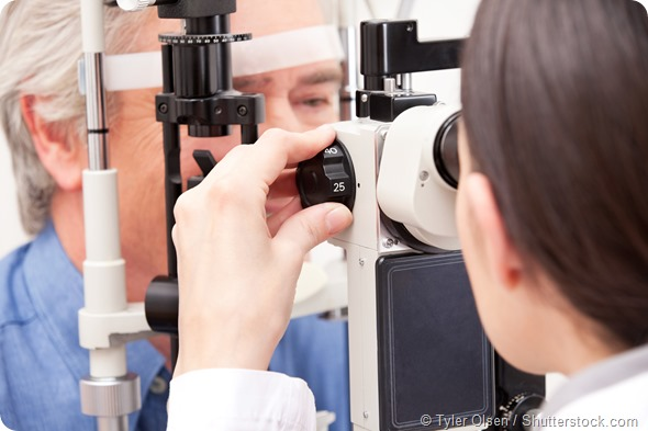Optometrist doing sight testing for pateient