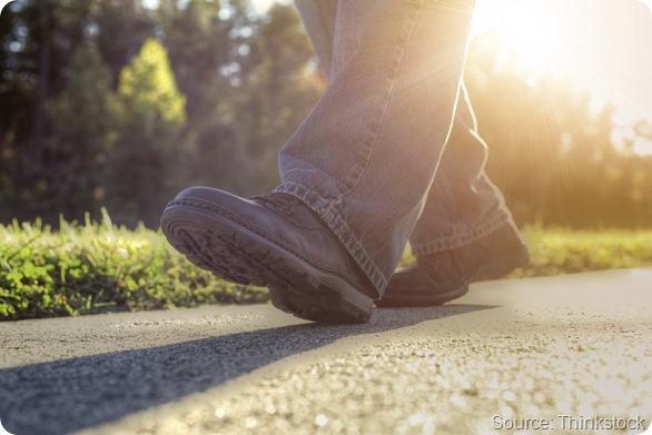Man walking on road.