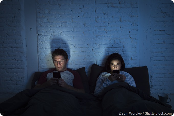 social media in bed couple