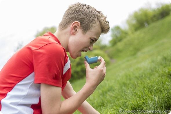teenager boy in sportswear run outside