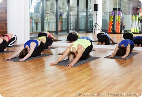 women stretching yoga